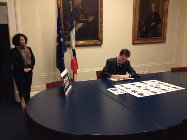 Nick Clegg visiting the French Embassy to pledge his support to the people of France by signing the book of condolence.