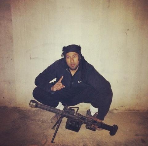 Imran Khawaja cradling a gun in a terrorism training camp in Syria. Image: Met Police
