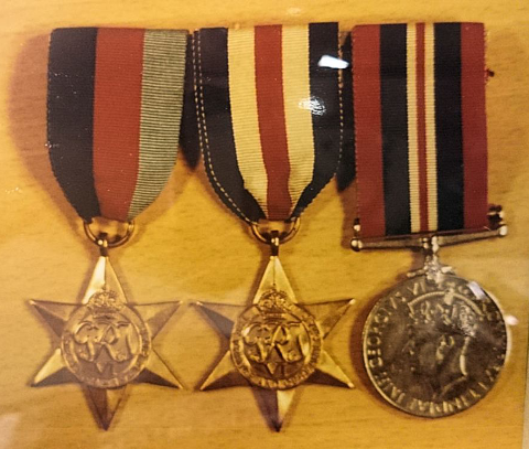 Three of the stolen medals. Some of the medals have 'W ELLIS 598200' engraved on the edge.