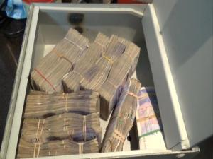 Money was found in a safe under the floorboard. Image: Met Police.