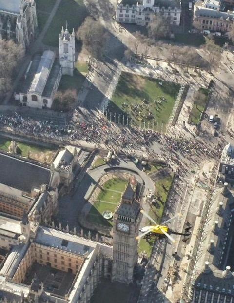 Protesters gather in Westminster to hear speeches saying government is not doing enough about climate change. Image: @MPSinthesky