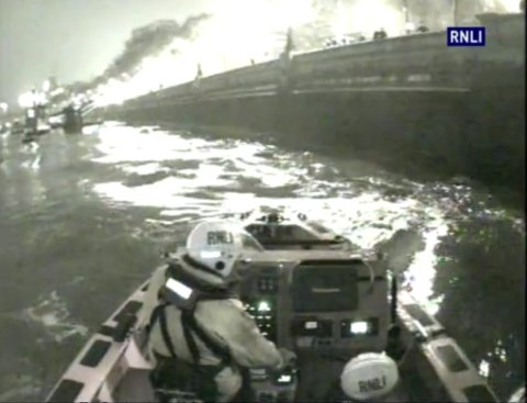 Tower Bridge RNLI about to pull three men out of the River Thames Tuesday morning 17th March 2015. Image: RNLI