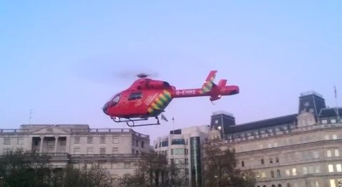 London's Air Ambulance landing in Trafalgar Square to give assistance to a woman who had fallen from one of the lion statues. Image: https://www.youtube.com/embed/_9MNEN7ZevU