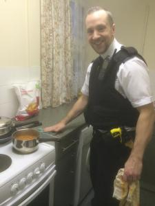 PC Andrew Stone helps out in the kitchen.  image:www.facebook.com/MPSKingston