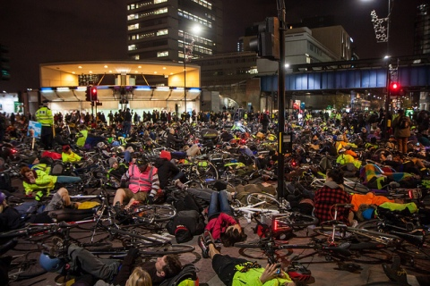 """Cycling die-in protest outside Transport for London headquarters"" by Nicolas Chinardet (en:User:Zefrog) - Shared directly by author. Licensed under CC BY 3.0 via Wikimedia Commons"