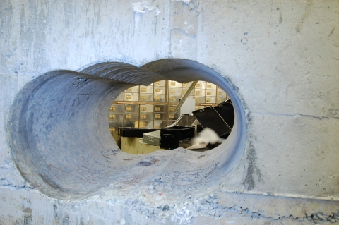 This is the hole cut out through the vault wall by the Hatton Garden jewellery thieves. Image: Met Police