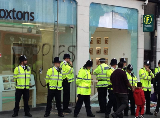 Police guard the estate agent. Image: @allmark21