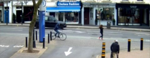 George O'Hare about to swoop on his bicycle as unsuspecting smartphone is using her mobile while walking in Fulham. Image: Met Police