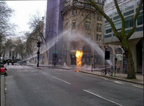 Shoot of flames being doused in water from street cover during Kingsway fire. Image:@LFB
