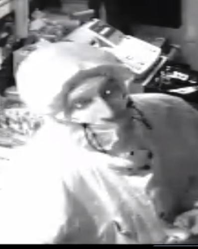 Suspect B in Dagenham shop raid. Image: Met Police