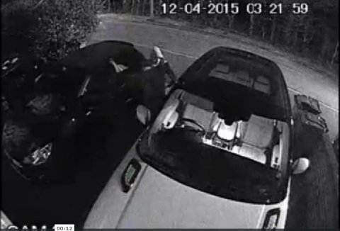 The moment a man in a hoodie stealthily, quietly and in a matter of seconds steals a new car from owner's driveway in 'keyless theft.' Image: Met Police