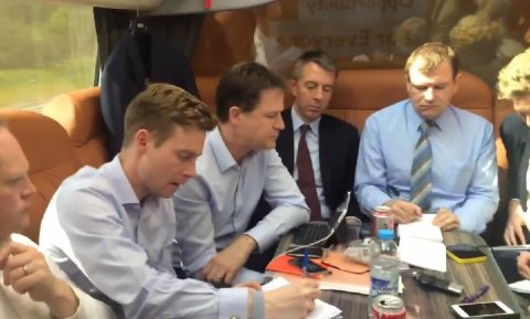 LibDem Leader Nick Clegg with mini-laptop, smartphone and journalists on campaign bus. Image: @nick_clegg