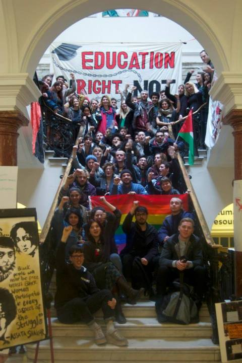 Occupy Goldsmiths students filling the main staircase with banners of Deptford Town Hall- the University's main management building. Image: Occupy Goldsmiths