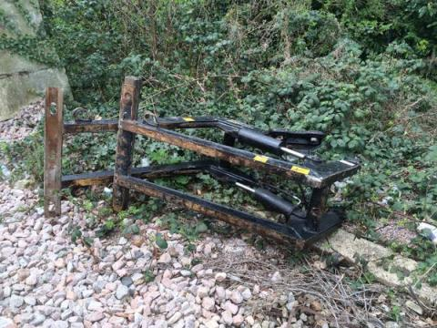 Remains of 'grabber' part of Cherry Picker lorry that landed onto the track after colliding with railway bridge. Image: @LFB