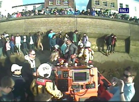 RNLI vessel rescuing stranded Boat Race spectators trapped by the rising tide at Chiswick. Image: RNLI
