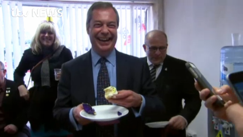 Nigel Farage eating a cupcake. Image: ITV News. See video at: http://www.itv.com/news/2015-04-07/farage-ukip-has-moved-on-from-being-fruitcakes/
