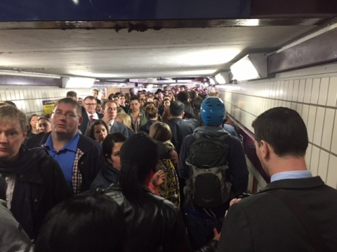 Anxious commuters crowded into claustrophobic tunnel between Clapham Junction platforms. Image: Sheila Smith