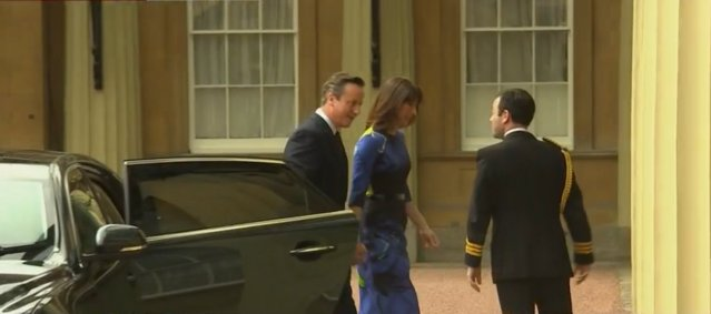 David Cameron and his wife Samantha go to Buckingham Palace for audience with the Queen. Image: BBC Live TV News screengrab.