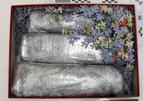 Drugs disguised in a children's puzzle set. Image: Met Police.