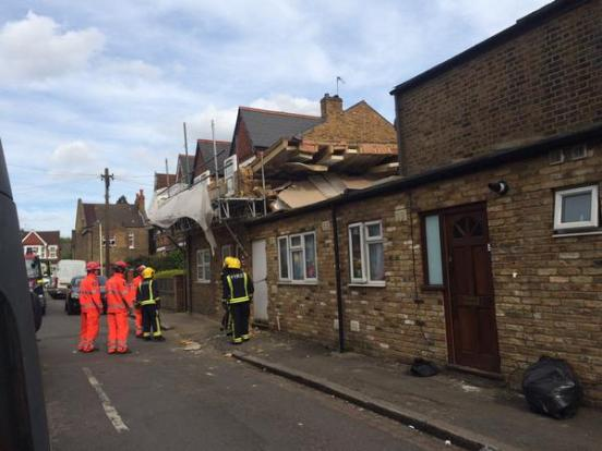 Firefighters securing the building after it collapsed in West London. Image: @LondonFire