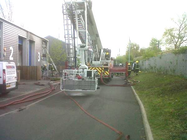 LFB firefighters prevent industrial estate fire spreading. Image: @LondonFire