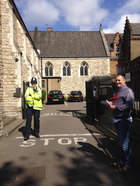 Our Lady and Catherine of Siena Church, Bow Road. Labour councillor Mark Francis, operating as 'Teller' outside.