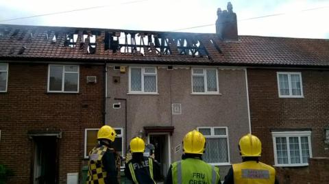 Roofs of two terraced houses damaged by fire in Keedenwood Road, Bromley. Image: @LondonFire