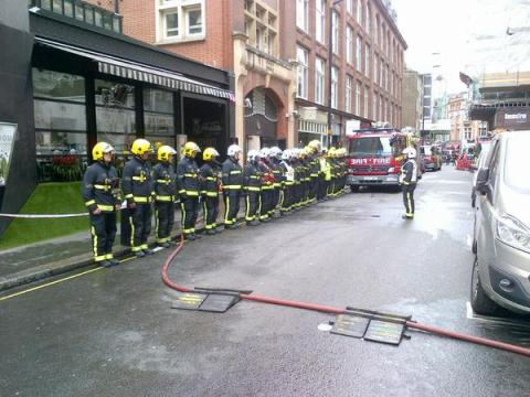London Firefighters parade in Wardour Street in respect for VE Day after tackling kitchen blaze. Image: @LondonFire