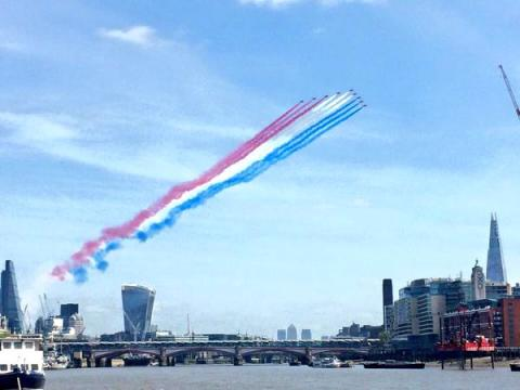 The Red Arrows streak over the River Thames. This wonderful image taken by @TowerRNLI