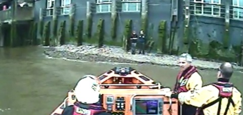 Two Polish tourists rescued from rising tide on River Thames bank near Tower Bridge. Image: RNLI