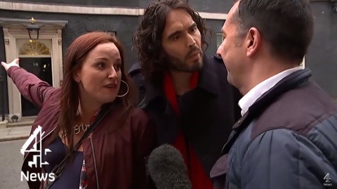 Lindsey Garrett and Russell Brand outside 10 Downing Street