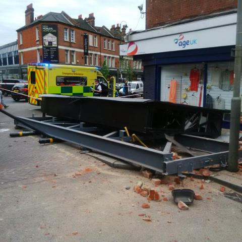 Advertising billboard falls to the street injuring woman. Image: @LondonFire