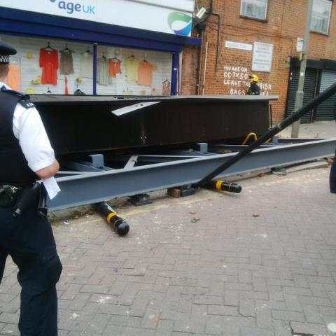 Fallen billboard that trapped a woman pedestrian. Image: @LondonFire