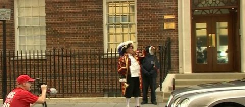 Unofficial town crier gives news of the birth. Image: Screen grab from BBC News.