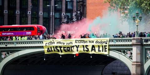 UK Uncut unfurl banner and let off coloured smoke-bombs on Westminster Bridge. Image@UKuncut
