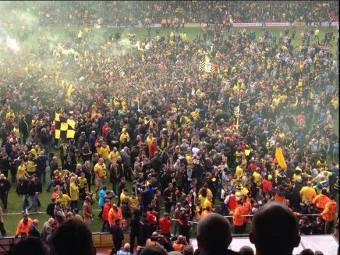 Hornets fans celebrate promotion to the Premiership at Vicarage Road after drawing 1-1 home to Sheffield Wednesday. Image: @watfordfcsays
