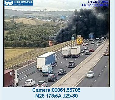 M25 closed by black smoke and flames from cheese lorry fire.
