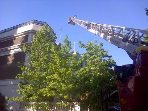 LFB firefighters confining blaze to top floor and roof of incident in Craven Hill.