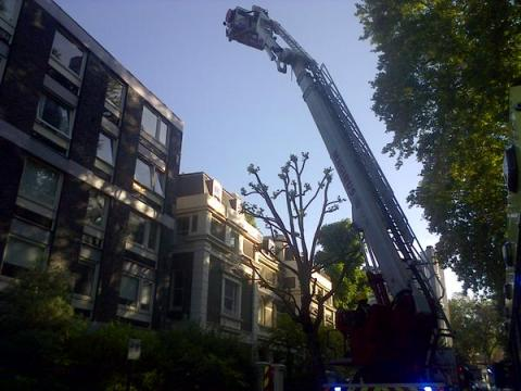 Aerial ladder and turntable equipment used  to tackle tal three story building fire. Image: @LondonFire