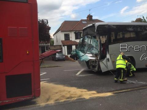 Damage to front of coach after collision with a London bus. Image:  RTC involving a bus & coach on Broadmead Road. Image:@LAS_HART