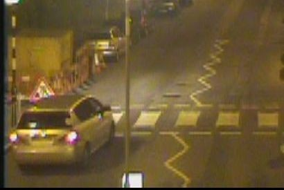 CCTV image of the Toyota Corolla Verso seen close to the scene of 'hate crime' arson attack on community centre. image: Met Police