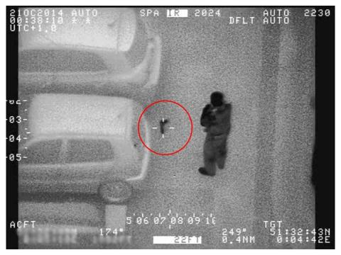 The moment officers recover a loaded gun, discarded by Mohamed Alasow NPAS London had tracked in Ilford. Image:@NPASLondon