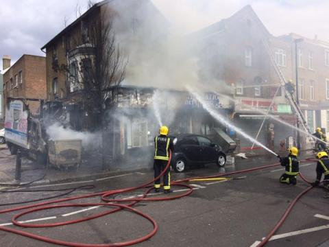 LFB firefighters train hoses on shop fire in Upper Holloway. Image:@LondonFire