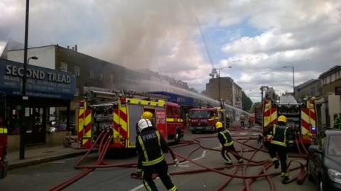 London firefighters battling the fire in a block shops in Yorkton Street. Image: @LondonFire