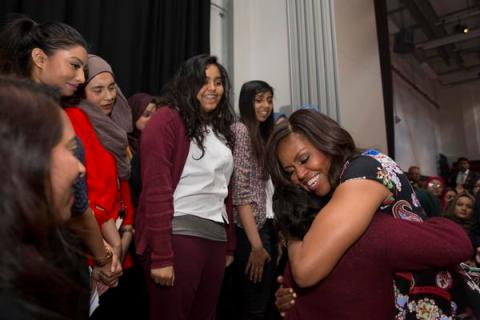 The First Lady Michelle Obama embracing the achievements of Mulberry School for Girls in Tower Hamlets as part of her global 'Let Girls Learn' project. Image: @FLOTUS