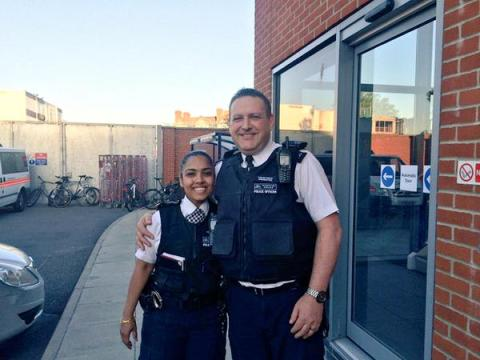 The two police officers who disarmed the man threatening them with a knife. Image: @MPSWForest