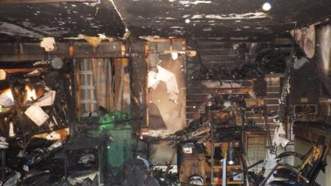 Damage to a scenery workshop in Peckham believed to have been caused by discarded cigarette. Image: @LondonFire