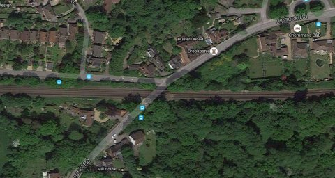 Shottermill Road and railway bridge leading to Liphook Road, Haslemere. Image: Google Satellite