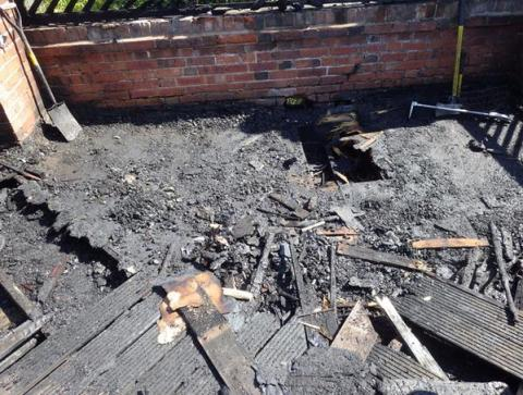 Decking destroyed in Balham. Fire investigators suspect sunlight through glass may have been the cause. Image: @LondonFire