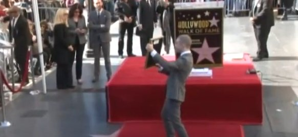 Harry Potter actor Daniel Radcliffe taking applause in Hollywood after receiving Walk of Fame award. Image: Screengrab from Press Association Youtube video.